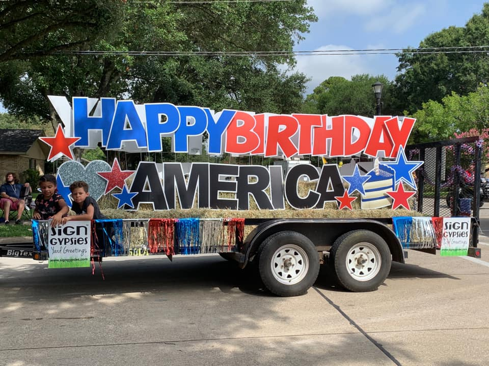 trailer with a sign that ready Happy Birthday America